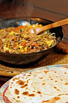 Moo Shu Pork with Homemade Pancakes | Marinated pork chopped thin with vegetables in a aromatic sauce all wrapped in a handmade, soft pancake with hoisin sauce. That's a dinner!