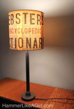 DIY book page pipe lamp.  I love everything about this!