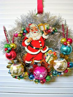 Vintage Santa Kitsch Christmas Wreath, I am sure my Mom still has old ornaments like this. LOL
