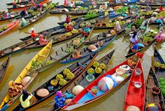 Floating market: Oh the colors!... I love going to local markets wherever I travel to.