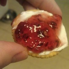 Spread a Ritz cracker with cream cheese and top w/raspberry jalapeno jam.  Delicious!