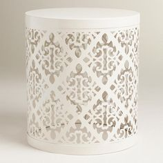 White Lailani Stool from World Market. Would make a cute bedside table for a kid's or guest bedroom.