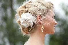 Soft braided upstyle, lovely flower and veil accessory