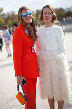STREET STYLE SPRING 2013: PARIS FASHION WEEK - Anna Dello Russo is well suited, next to a more feminine and feathered designer.