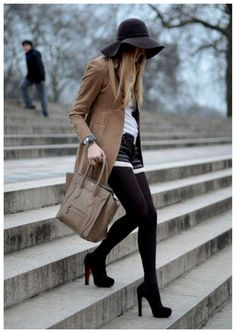 black opaque tights, heels, creme top, beige jacket and black floppy hat. perfection