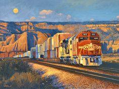 Santa Fe train traveling through New Mexico, USA, at dusk.