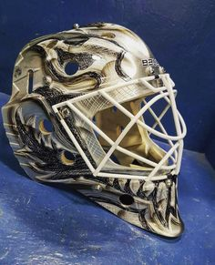 See more goalie mask painting ideas on our complete guide of ideas. Goalie Gear, Goalie Mask, Hockey Goalie, Ice Hockey, Nhl, Mask Painting, American Games, Coaches, Mask Design