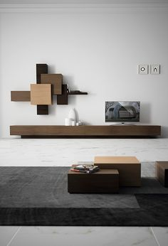 A shelving and cabinetry system that uses simple shapes  to create cubbies and shelves. #wood #shelves #cabinet #YankoDesign