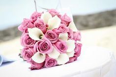 Soft pink roses and lovely white calla lilies create simple but stunning Bahamas bridal bouquet #Bahamas #Wedding