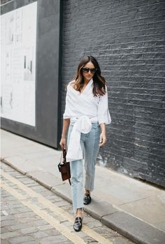 Beat the heat with this roundup of stylish work wear inspiration for summer | 'Soraya Bakhtiar' in white wrap top, denim slacks, and patent leather loafers
