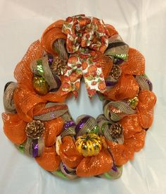"Harvest Wreath. Golden pumpkin, gourds, pine cones sit on metallic orange and tan, purple, green stripe mesh. Sparkle pumpkin print bow. 18"" by KhQualityCreations on Etsy"