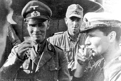 Erwin Rommel, known as the Desert Fox, (left) was photographed enjoying a toast with the officers of an Italian submarine, possibly the Foca Class Atropo, during a visit to Bardia. Rommel and his army developed almost legendary status for their efforts during the conflict, with many British generals expressing a begrudging admiration for him