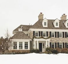 Traditional home covered in snow