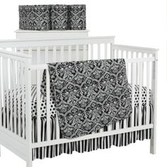 Cute bedding. You could add a pink, yellow or light green wall and that would make it so cute!