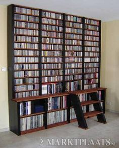 50 Ideas Dvd Storage Ideas Living Room Libraries For 2019 Dvd Storage Units, Dvd Storage Tower, Dvd Storage Solutions, Dvd Storage Cabinet, Dvd Storage Case, Dvd Shelves, Diy Garage Storage, Storage Ideas, Book Lovers