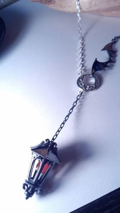 Lantern necklace by Isoguten.
