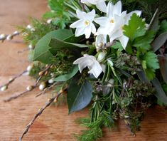 Winter flower arrangement--- love the inclusion of herbs!  They add so much texture and softness.