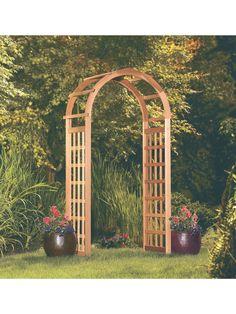 Arched Cedar Arbor Adds Year Round Interest