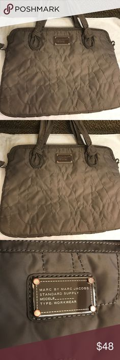 Marc Jacob laptop bag Great bag that has some used with missing Crossbody straps and the side hook were the crossbody strap goes needs sewing and needs new hook but Bag can still be use as Tote since the handle still intact. Marc Jacobs Bags Laptop Bags