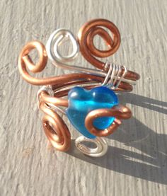 Spiral Copper and Silver wire Ring by BeezDezignz on Etsy Wire Rings, Heart Shapes, Spiral, Glass Beads, Copper, Personalized Items, Silver, Etsy, Jewelry
