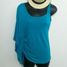 Fancy Little Top Summer top in great condition. This is classy and fun.  100% rayon It is sized a large but runs small. Thank you for shopping  Rhapsody Tops Tank Tops