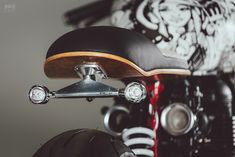 A Triumph Thruxton cafe racer with a street art vibe by Hans Bruechle