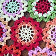 Japanese Flower Scarf Motif used to crochet a round centerpiece for my dining room table.