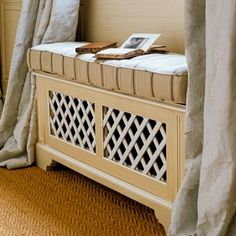 When hiding a radiator in a window seat, sheathe the face with lattice panels to let heat escape. A hinged top allows the radiator to be easily accessed and serviced. | Photo: Andreas von Einsiedel/Alamy | thisoldhouse.com