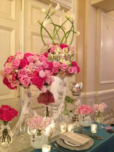 Our booth at the Wedluxe 2014 show on Sunday 5th January. Unique ceremony floral arrangement design. Base of hot pink , pink and blush roses , pink hyacinth and pink cyclamen on green and pink antique hydrangeas with centre candles creating a soft illumination of the woven crown of white Calla lilies.