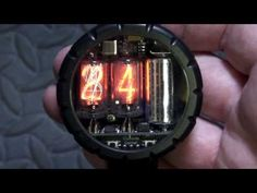 The Cathode Corner Nixie Watch displays the time on nixie tubes, which are quaint neon display tubes once used in calculators in the dawn of recorded history It is a two-digit wristwatch designed for everyday use, being water-resistant and rugged. Nixie Tube Watch, Cyberpunk, Cool Watches, Watches For Men, Skeleton Watches, Tube Youtube, Watch Display, Retro Futuristic, Vacuum Tube