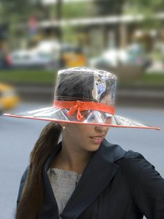 you don't come across these clear rain hats very often - so cute