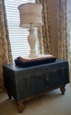 Repurposed antique trunk to end table