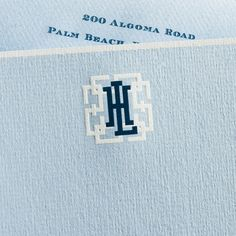 Powder Blue Empire Card with White Border and Monogram in White and Regent Blue.
