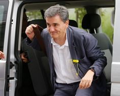Eurogroup Finance ministers meeting<br>epa04843455 Greek Finance Minister, Euclid Tsakalotos arrives for the start of a special Eurogroup Finance Ministers meeting, on the Greek crisis, at the European Council headquarters in Brussels, Belgium, 12 July 2015. Eurozone Finance Ministers set 12 July 2015 as the deadline to reach an agreement saving Greece from bankruptcy, amid warnings that failure to strike a deal by then could lead the country to crash out of the eurozone. EPA/OLIVIER HOSLET