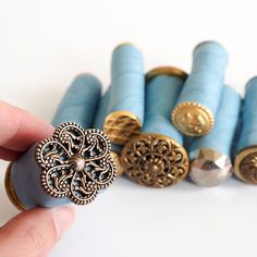 I would glue the buttons to wine corks