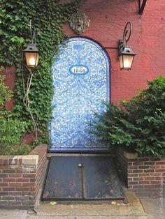 pretty door but isn't having trap door just outside it kind of cartoonish?