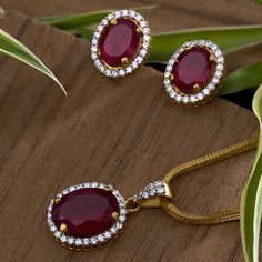 Gemstone Pendant Set jewellery for Women by jewelegance. ✔ Certified Hallmark Premium Gold Jewellery At Best Price Jewelry Design Earrings, Gold Earrings Designs, Gold Jewellery Design, Gemstone Jewelry, Diamond Jewellery, Gold Wedding Jewelry, Gold Jewelry Simple, Gold Mangalsutra Designs, Gold Chain Design