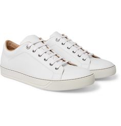 Lanvin was one of the first to popularise wearing sneakers with tailoring, so try this pair with a suit. They're made from smooth white leather and have supple linings and gripped rubber soles. Gold Shorts, Short Waves, Lanvin, Leather Sneakers, White Leather, Dust Bag, High Top Sneakers, Lace Up, Pairs