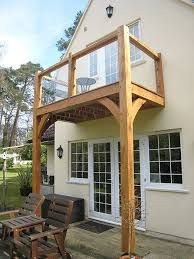 Very tall balcony with oak frames and toughened glass panels...can anyone say 'acrophobia' (fear of heights)?