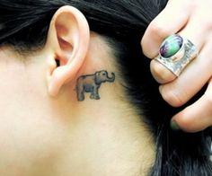 small elephant tattoo behind ear