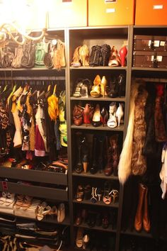 Suzie: Heights of fashion - Guest bedroom converted into walk-in closet with orange storage ...