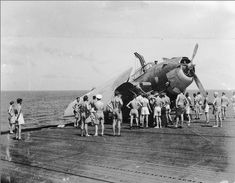Grumman Avenger JZ208 1G flown by SLt. CH Whitehead being recovered from the port catwalk where it ended up after catching No6 wire and hitting No2 barrier landing on Shah Jan12 1945 HMS Shah was a Ruler-class escort carrier in the Royal Navy. Her duties were chiefly convoy defence and trade protection against German U-boats operating in the Indian Ocean with a shore base at Trincomalee. #HMSShah #HMSShahD21 #aircraftCarrier #escortCarrier #royalnavy #Avenger #GrummanAvenger #bomber