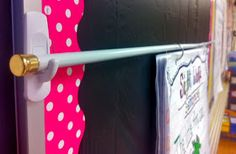 Hang anchor charts with command hooks and a cheap tension rod