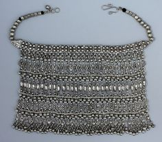 This silver labbeh necklace was probably made in Yemen, but it was collected in Ethiopia and sold in New York in the 1960s. It has 180 bells, 120 filigree parts, 120 figure eights, hundreds of jump rings, and 17 boxes.