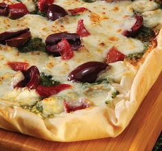 Print Recipe Ingredients: 2 cups fresh basil 1/4 cup pine nuts, lightly toasted 1 garlic clove, peeled 1/2 cup grated Parmesan cheese 1/2 cup olive oil Salt and pepper to taste 20 sheets Athens® Fillo Dough (9″x14″), thawed 1 cup Kalamata olives, pitted and halved 1 1/2 cups mozzarella cheese, diced small 1/2 cup roasted …