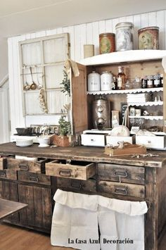 Love this cabinet and the old window frame used as a hanger for a bevy of kitchen items
