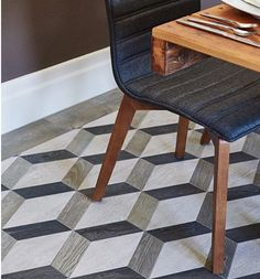 Exciting and eye-catching, these geometric porcelain floor tiles bring a pop of life to any room they're in! Featured here is the Oxford Pattern in Charcoal from the Sterling Row collection by Walker Zanger. You can buy these tiles and more at Byrd Tile Distributors in Raleigh, NC. #ByrdTile #porcelaintiles #floortiles #tileinspo