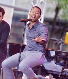 "Snapshot: July 10 - John Legend   - John Legend gets lifted during a performance on the ""Today"" show on July 10 in New York"
