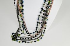 Multicolor Necklace with three layers of different beads and pearls. Antique gold clasp.