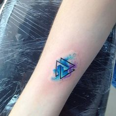 Watercolor style valknut as trefoil knot or triquetra on the right inner forearm. Tattoo artist: Adrian Bascur